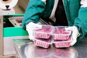 Raspberries in clear plastic packaging